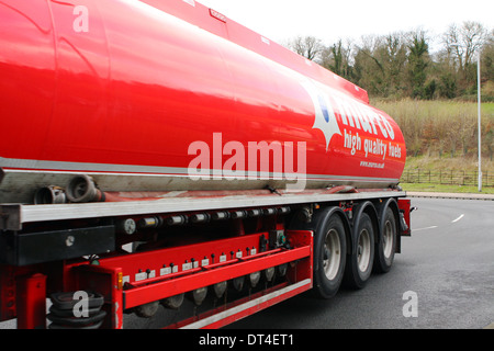 Part of a Murco tanker traveling along a road in Coulsdon, Surrey, England - Stock Photo
