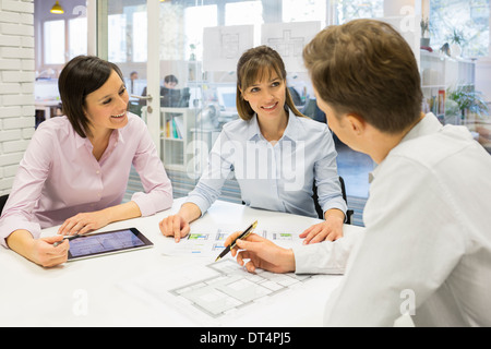 Cheerful Architect team working in meeting room - Stock Photo