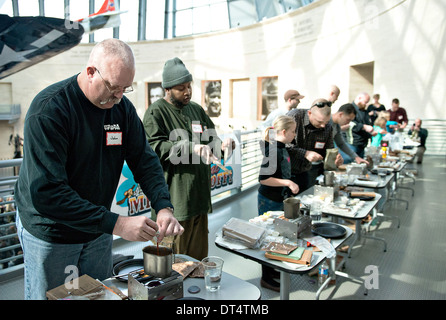 Contestants in the National Museum of the Marine Corps Second Annual MRE Cook off begin combining prepackaged rations - Stock Photo