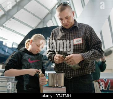 Gunnery Sgt. Trevor Havens and his daughter take part in the National Museum of the Marine Corps Second Annual MRE - Stock Photo
