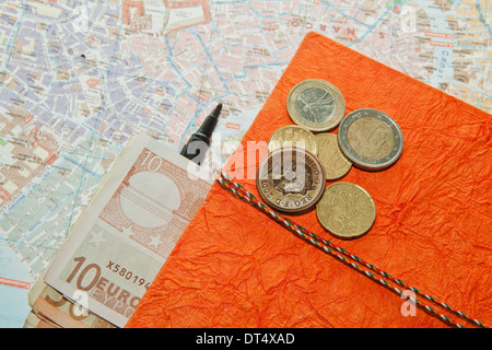 Travel Arrangement of Euro money, Map and notepad diary - Journal - Stock Photo