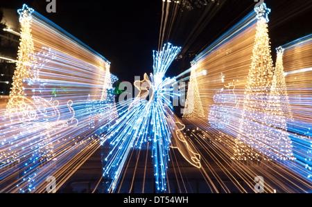 Christmas Sled Deers And Trees Bokeh Light Stock Photo