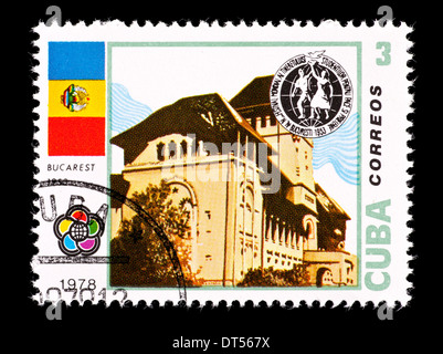 Postage stamp from Cuba depicting a building in Bucarest, 1953. - Stock Photo