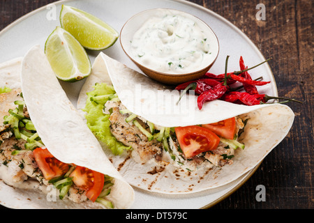 Tortillas filled with chicken and fresh vegetables close-up - Stock Photo