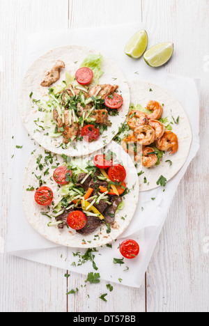 Tortillas filled with beef, chicken and shrimps - Stock Photo