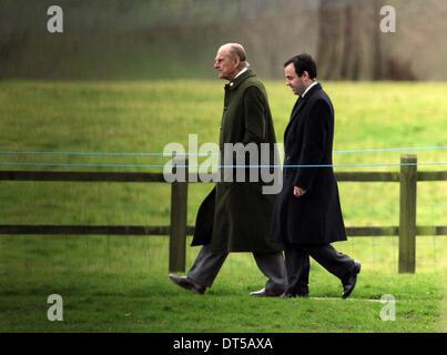 Sandringham, Norfolk, UK. 9th Feb, 2014. Prince Philip, Duke of Edinburgh, walks back to the house after attending - Stock Photo