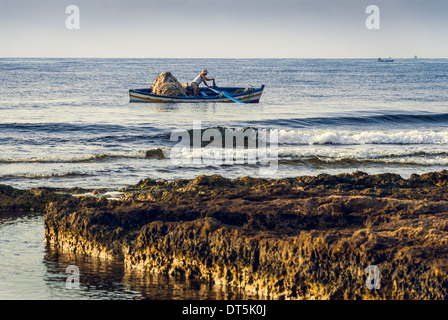 Fisherman in a Boat in the Morning - Stock Photo
