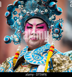 Proud Chinese man wearing makeup parades at the Lunar New Year Festival in Chinatown. - Stock Photo