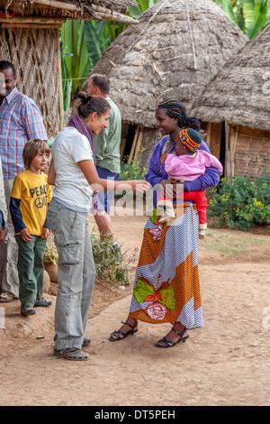 A Tourist Speaking To A Dorze Woman, Hayzo Village, Arba Minch, Ethiopia - Stock Photo