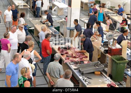 Funchal Madeira People buying fresh fish Mercado dos Lavradores - Stock Photo