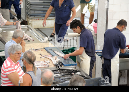 Funchal Madeira. Fish market.Fresh fish being prepared for sale in Mercado dos Lavradores - Stock Photo