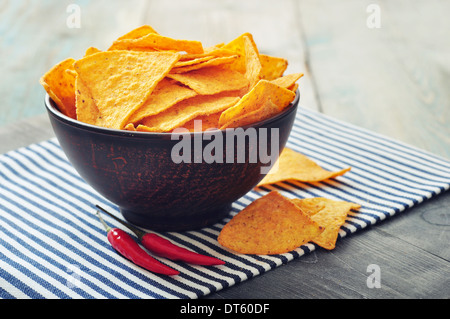Corn nachos in bowl on wooden backgrpond - Stock Photo