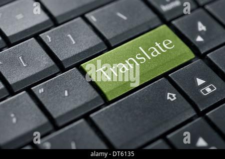 Translate button on computer keyboard closeup - Stock Photo