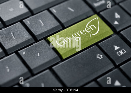 Go green button on keyboard of computer closeup - Stock Photo
