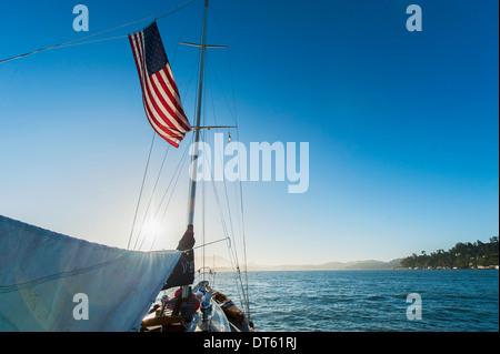 Yacht and American flag, Sausalito, California, USA - Stock Photo