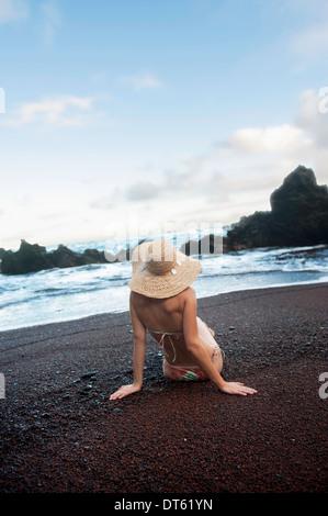 Young woman posing on beach, Hana, Maui, Hawaii - Stock Photo