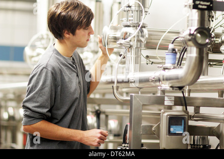 Man working in brewery - Stock Photo