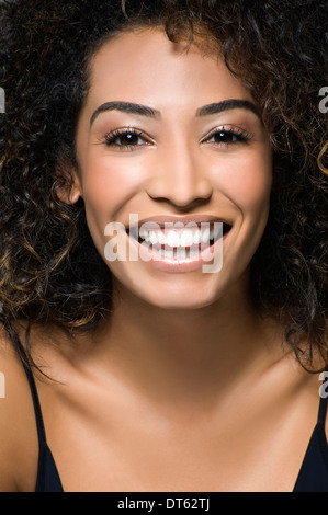 Close up studio portrait of happy young woman - Stock Photo