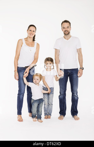 Studio portrait of parents with their young daughter and son - Stock Photo