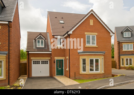 New build red brick detached house - Stock Photo