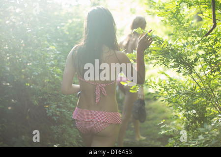 Friends walking on forest trail - Stock Photo
