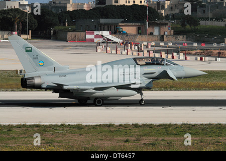 Eurofighter Typhoon fighter plane of the Royal Saudi Air Force taxiing for departure from Malta - Stock Photo