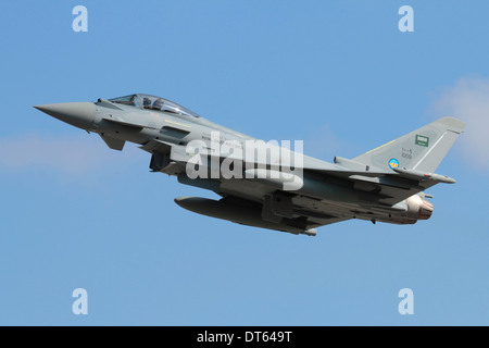 Military aviation. Eurofighter Typhoon jet fighter plane of the Royal Saudi Air Force flying and climbing on takeoff - Stock Photo