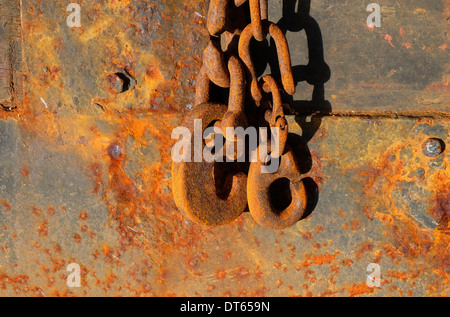 rusted chains and hooks on old rusty buoy, granville, normandy, france - Stock Photo