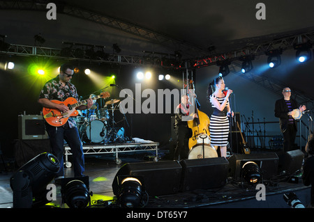 Music, Strings, Guitars, Irish Rockabilly singer Imelda May and her band performing at 2010 Cornbury Festival in - Stock Photo
