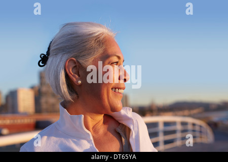 Close up profile of silver-haired mature woman - Stock Photo