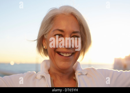 Close up portrait of silver-haired mature woman - Stock Photo
