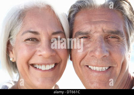 Close up portrait of happy couple - Stock Photo