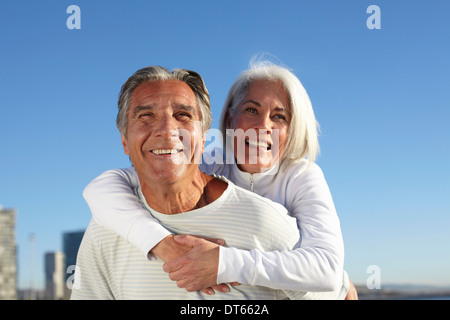 Portrait of happy couple outdoors - Stock Photo