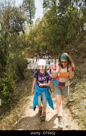Nepal, South Asia, Pokhara. Western family with children trekking in Nepali Himalayan hills near Pokhara. - Stock Photo