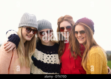 Four teenage girls wearing sunglasses - Stock Photo