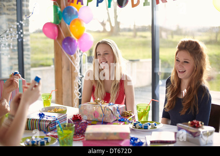 Teenage girl and friends enjoying birthday party - Stock Photo