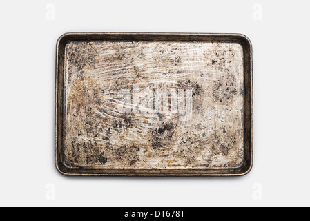 A well used, seasoned baking tray. Cookware. Baking sheet. - Stock Photo