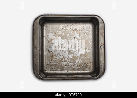 A well used, seasoned baking tray. Cookware. A square baking cake tin 9 inches square. Pan. - Stock Photo