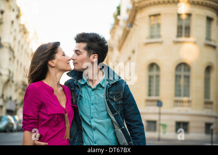 Young couple kissing on street, Paris, France - Stock Photo