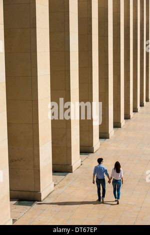 Young couple walking hand in hand, Paris, France - Stock Photo