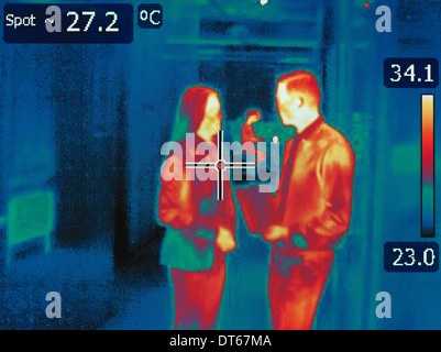 Infrared heat image of office workers in discussion - Stock Photo