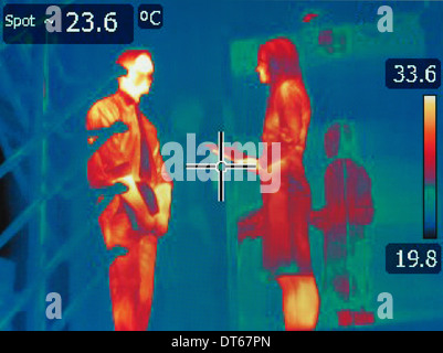 Infrared heat image of office workers in meeting - Stock Photo