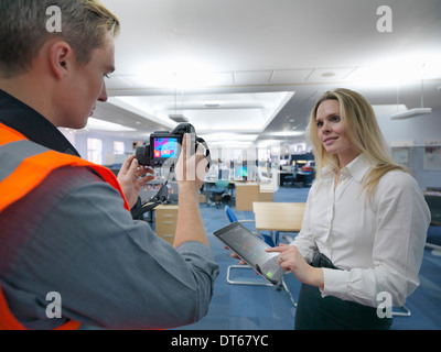 Office workers taking thermal infrared images in office to check heat efficiency