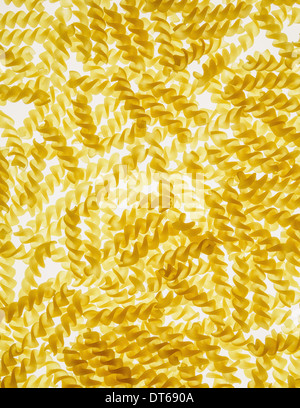 Organic gluten free fusilli pasta spirals, white background - Stock Photo