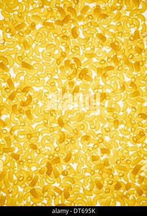 Organic quinoa macaroni pasta elbows, white background (pasta is gluten free) - Stock Photo