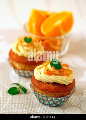 Orange cupcakes. Recipe available. - Stock Photo