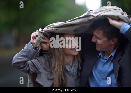 Young woman and mature man walking in park - Stock Photo
