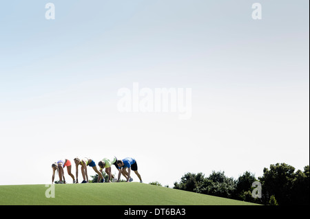 Group of adult runners preparing to run - Stock Photo