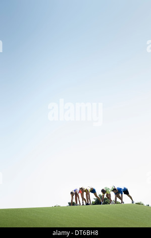 Group of adult runners preparing to start - Stock Photo