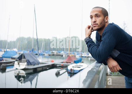 Portrait of young man in marina - Stock Photo